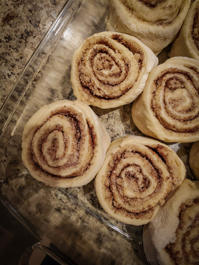 family cinnamon roll recipe: the secret to good cinnamon rolls. Cinnamon rolls prepared for the oven.